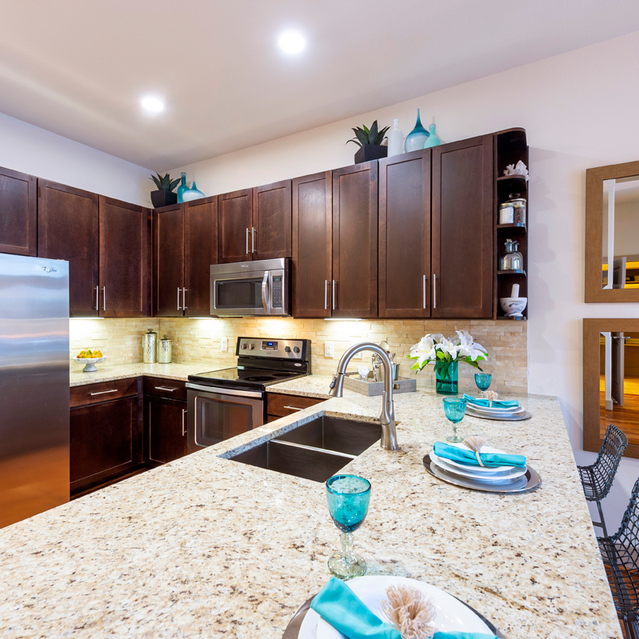 Espresso kitchen package at Block 334 Apartments in Houston, TX.