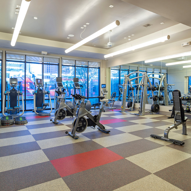 Fitness center equipment at Block 334 Apartments in Houston, TX.