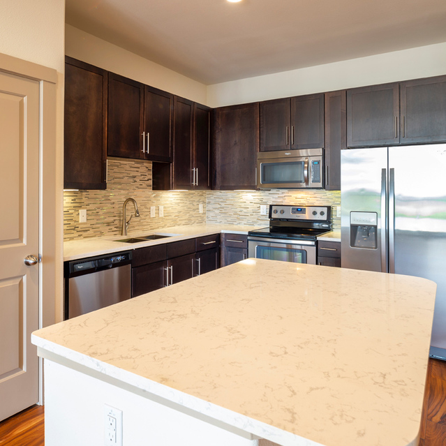 Kitchen islands at Block 334 Apartments in Houston, TX.
